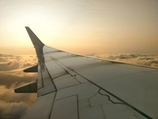 Airplane wing glowing in the Sunrise of Accra