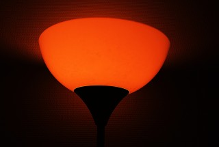 Glowing lamp in darkness with red effect